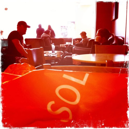Taken in a local cafe in 2012. iPhone+Hipstamatic app, Kaimal Mark II Lens, Kodot XGrizzled Film, No Flash. Copyright Malcolm Raggett